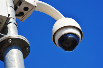 Hi-tech dome type camera over blue sky