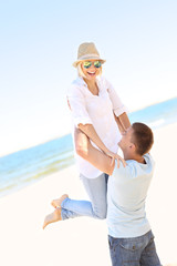Romantic couple having fun at the beach