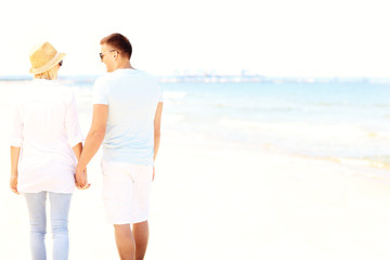 Young couple walking at the beach