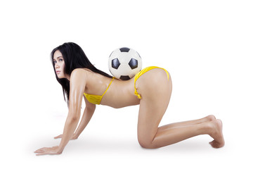 Sexy woman in bikini and soccer ball