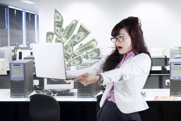 Shocked businesswoman looking money