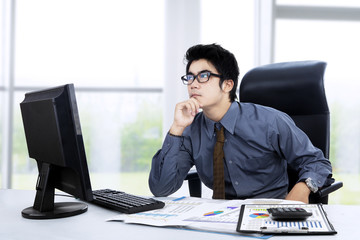Thoughtful young businessman at office