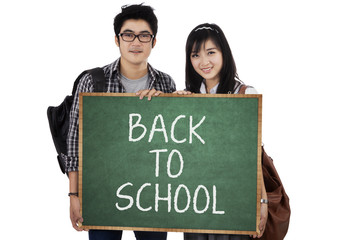 Two student holding small blackboard 1