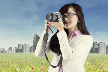 Woman with DSLR camera 1