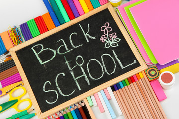 The words 'Back to School' written in chalk