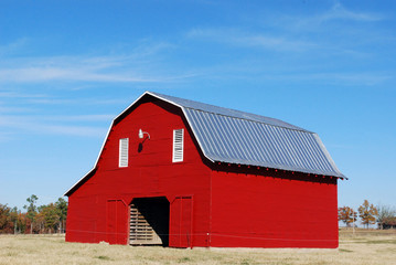 Red barn with metal gray roof