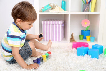 Cute little boy playing in room