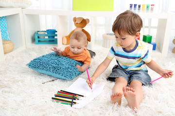 Cute little boys playing in room