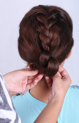 Creating hairstyles hairdresser close-up