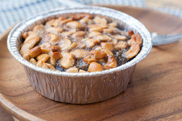 Close up image of walnut toffee cake