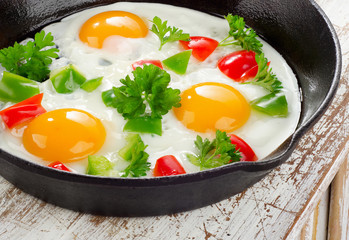 Fried eggs and vegetables