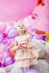 Lovely girl playing in game room of balloons