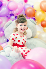 Image of merry little girl posing in playroom