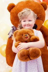 Charming little girl hugging favorite toy