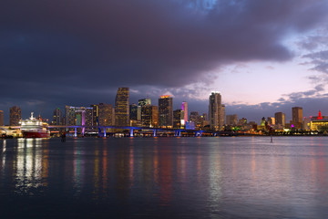 Urban landscape of Miami downtown at dusk with reflections.