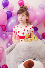 Image of amusing little girl with big teddy bear