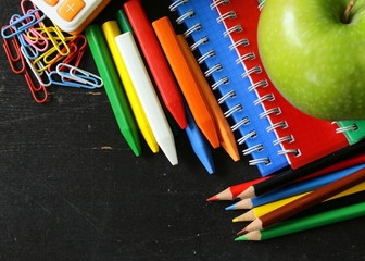Back to school concept, multicolored pencils and notebooks