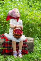 girl with a basket of raspberries