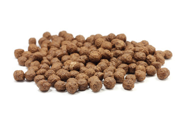 scattered chocolate balls on a white background