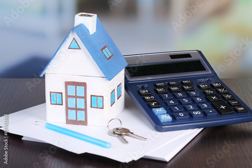 canvas print picture Toy house and calculator on table close-up