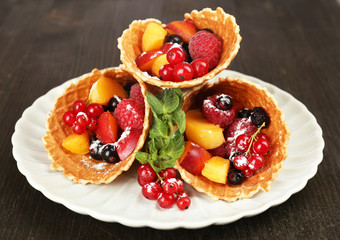 Fresh fruit dessert for healthy snack on wooden table close up
