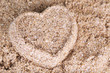 Heart-shaped wet sand, close-up