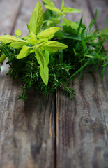bunch of fresh herbs on rustic wooden planks