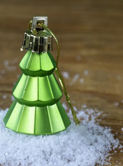 Christmas tree decorations on a wooden background