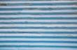 Alter schmutziger Hintergrund in Blau aus Blech