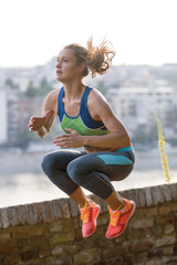 caucasian woman runner jogger jumping