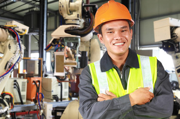 Man factory engineer or worker with robot machine
