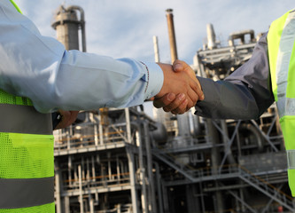 Two petrochemical contractors closing a deal