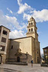 Pilgrim arriving Encina Church in Ponferrada, Bierzo, Spain.