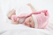 newborn baby seven weeks age in hat