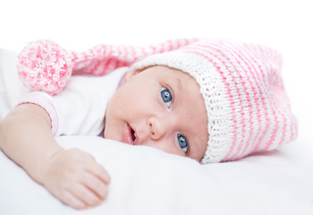 newborn baby seven weeks age in hat