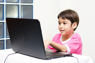 Little boys use laptop for education