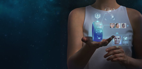 Unrecognizable woman holding wearable gadget