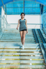 Sports woman walking stairs