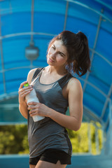 Woman drinking water sweating exercising