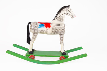 Children's wooden rocking horse on a white background