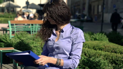Businesswoman finish work with documents and relax in the city