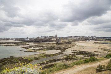 view of the shore from saint malo on a cloudy day
