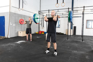 Clean and jerk workout at fitness gym center