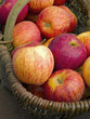 Baskets with fresh red apples for sale.