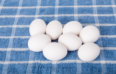 Fresh Eggs on Blue Towel
