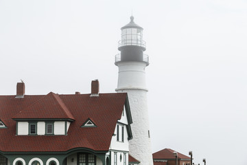 Red Roof and Foggy Lighthouse