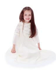 dark-haired little girl in a white dress