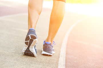 Woman Ready to Run on Track Lane