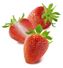 Two whole strawberries and one half isolated on white background