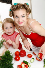 Happy housewife with little daughter